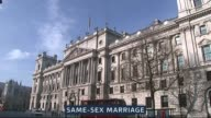 Legacy DATE London Whitehall Rainbow flag over Whitehall to celebrate first same sex marriage ceremony with graphic overlaid