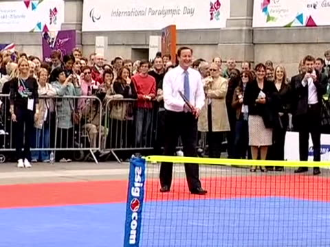 David Cameron playing a game of doubles with Boris Johnson and wheelchair tennis players