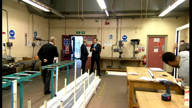 David Cameron speech on punishment and rehabilitation of offenders Wormwood Scrubs Prison David Cameron touring workshop in prison accompanied by...