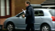 campaigning in Oldham / car repair centre visit ENGLAND Greater Manchester Oldham EXT Long shot cars arriving David Cameron MP along from car and...