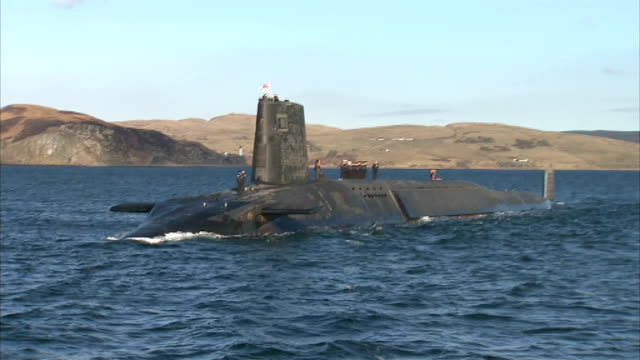 David Cameron touring submarine HMS Victorious SCOTLAND En route to Faslane SHOT of coasline and lighthouse INT BOAT Crew member on board boat EXT...