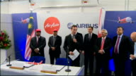 David Cameron tours Airbus factory and AirAsia sign contract AirAsia model plane / Fabrice Bregier Tony Fernandes and Cameron along at press...