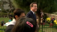 David Cameron trade visit continues INDIA New Delhi Janki Devi Memorial College EXT David Cameron MP along with Aamir Khan and others towards...
