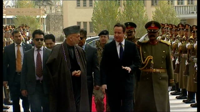meeting President Karzai in Kabul and British troops at Camp Bastion AFGHANISTAN Kabul EXT David Cameron MP out of car and shaking hands with...