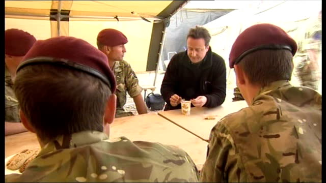 David Cameron visit to Camp Bastion EXT David Cameron inspecting biscuits and snacks on offer in mess tent David Cameron seated chatting with group...