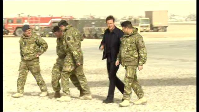 David Cameron visit to Camp Bastion More of David Cameron talking to British troops and inspecting military vehicles/ David Cameron signs his name on...