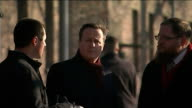 David Cameron visits Auschwitz Unidentified Location Auschwitz EXT David Cameron stands talking with others during visit to Auschwitz David Cameron...