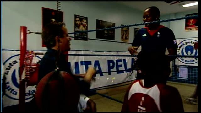 Rio De Janeiro Fight for Peace boxing gym EXT David Cameron MP towards chatting to Luke Dowdney and others David Cameron chatting with Luke Dowdney...