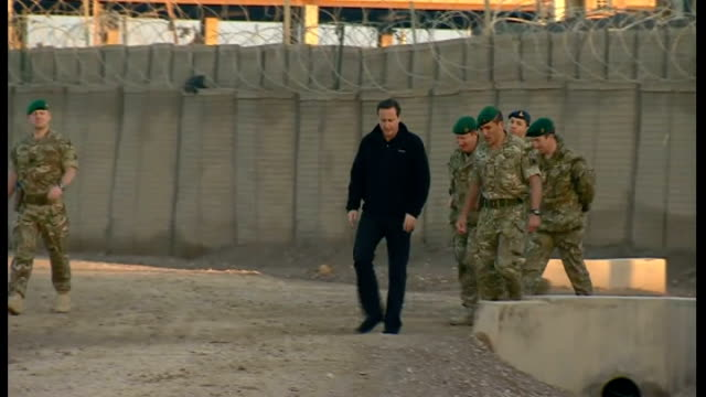 David Cameron visits British soldiers AFGHANISTAN Helmand Province Camp Bastion INT HELICOPTER British soldier on board military helicopter / back...