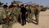 David Cameron visits British troops in Helmand Province AFGHANISTAN Lashkar Gah Camp Bastion INT David Cameron MP sitting chatting with British...