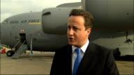 David Cameron visits Brize Norton air base ENGLAND Oxfordshire Brize Norton RAF Base EXT David Cameron MP along with RAF officer David Cameron SOT...