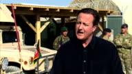 David Cameron visits Camp Bastion AFGHANISTAN Helmand Province Camp Bastion EXT British troops hosing down armoured vehicles Mastiff in biowashdown...