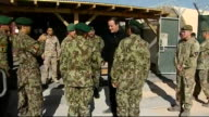 David Cameron visits Camp Bastion AFGHANISTAN Helmand Province Camp Bastion EXT David Cameron MP being introduced to soldiers from the Afghan...