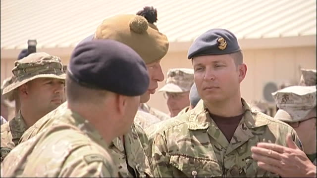 David Cameron visits Camp Bastion Back view of crowd of soldiers listening to Cameron making speech SOT / Cameron chatting to troops / soldiers next...