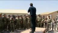 David Cameron visits Camp Bastion Cameron making speech to troops SOT / soldiers listening to Cameron's speech and laughing / more shots of Cameron...