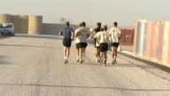 general views and speech AFGHANISTAN Helmand Province Camp Bastion EXT David Cameron MP jogging through camp with British troops during earlymorning...