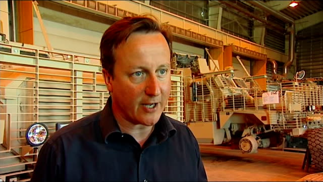 David Cameron visits Camp Bastion People standing inside warehouse David Cameron MP interview SOT On missing soldier in Lashkar Gah / why he didn't...