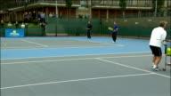 David Cameron visits LTA Roehampton tennis centre Cameron and Rusedski playing doubles match