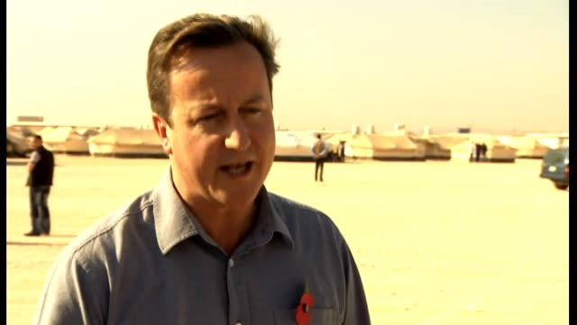 David Cameron visits refugee camp JORDAN EXT David Cameron MP interview SOT Pilots in cockpit / control panel / pilot / helicopter on ground seen...