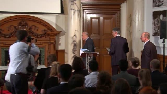 David Davis urges Brexit trade talks HM Treasury Angel Gurria and Philip Hammond MP arriving at OECD press conference Angel Gurria speaking at podium...