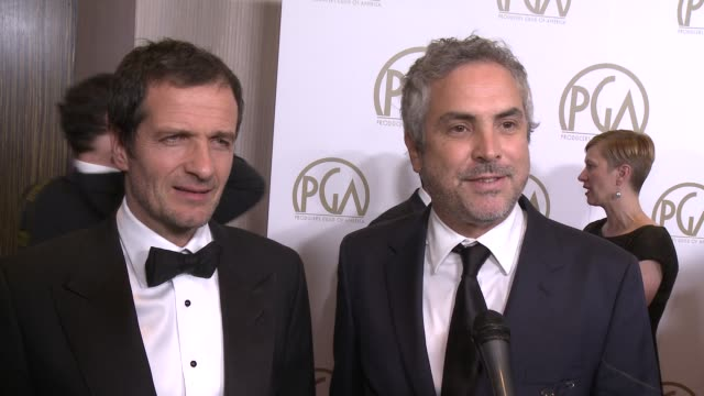 INTERVIEW David Heyman Alfonso Cuaron on 'Gravity' at 25th Annual Producers Guild Awards at The Beverly Hilton Hotel on in Beverly Hills California
