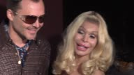 David LaChapelle Amanda Lepore and Pamela Andersen at the 14th Annual Elton John AIDS Foundation Oscar Party Cohosted by Audi Chopard and VH1 at the...