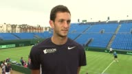 James Ward and Andy Murray practising on court James Ward interview SOT on why Davis Cup special / different atmosphere to other tennis tournaments /...