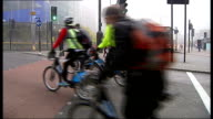 World Economic Forum T11121302 / TX ENGLAND London People riding London hire bicyles along Boris Johnson Tim Clark and Emirates stewardesses posing...