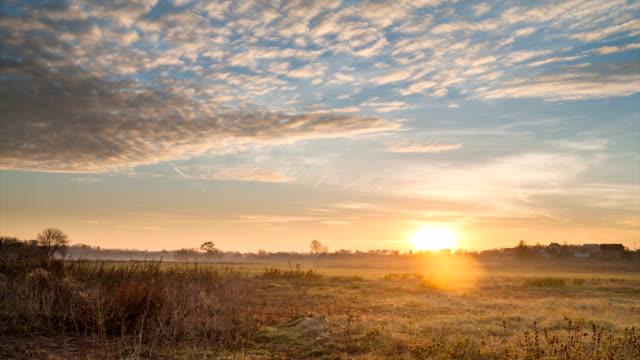 Dawn. Sunrise in the field.