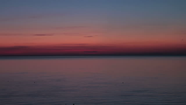 Dawn, Sunrise over the sea; time lapse skyscape