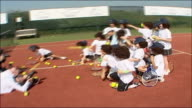 Day 5 TX Andy Murray and schoolchildren wearing wigs throwing tennis balls at photographers