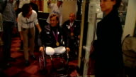 Day 7 Alex Zanardi interview ENGLAND Kent Brands Hatch EXT Alex Zanardi along in wheelchair and into building as greets woman INT Zanardi chatting...