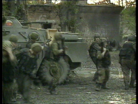 VE Day anniversary celebrations CHECHNYA Grozny MS Wounded Russian soldier away assisted by others