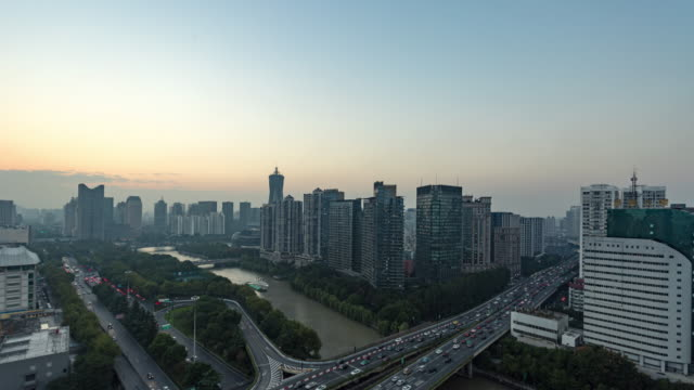 Day to Dusk 4K Time-lapse:Rush hour traffic on highways through downtown area by the Grand Canal,Hangzhou,China