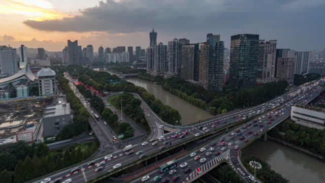 Day to Dusk 4K Time-lapse:The Grand Canal flowing through Hangzhou city against sunset,China