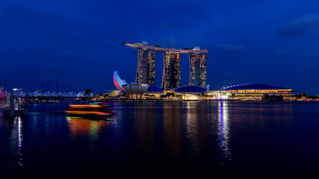 Day to night looking at Marina Bay Sands Hotel