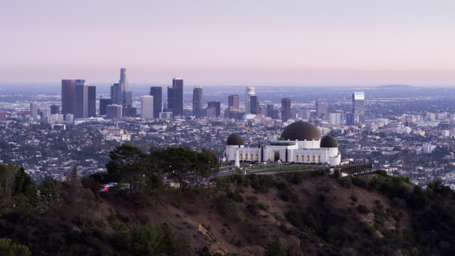 T/L, LS, HA Day to night of Griffith Observatory and Los Angeles skyline / Los Angeles, USA