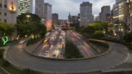 TL, WS, HA Day to night of traffic in central Sao Paulo on a curved flyover / Sao Paulo, Brazil