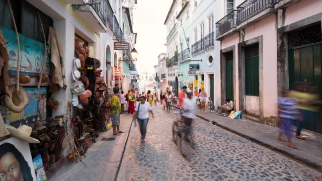 TL, WS Day to night, people walk through the historic district of Pelourinho / Salvador, Brazil