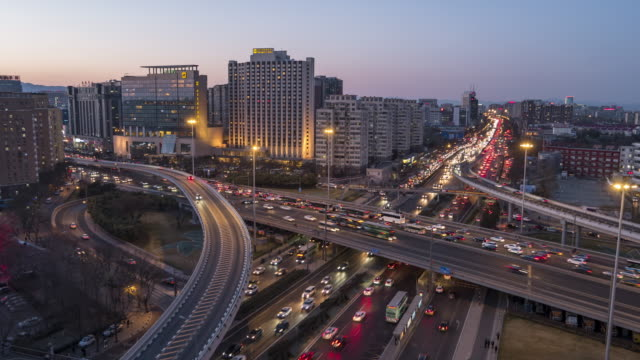 T/L PAN Day to Night Rush Hour Traffic Spirals / Beijing, China