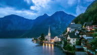 4K Day to Night Time-lapse: Hallstatt Village Cityscape lake Austria