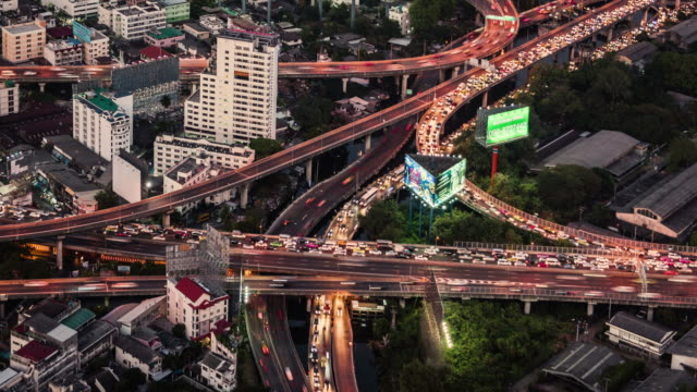 day to night timelapse of road intersection in central Bangkok
