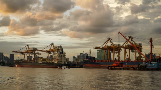 day to night TL: stacking container into industry ship