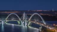 TL, LS, HA Day to night, traffic crosses Ponte Juscelino Kubitschek (bridge) at rush hour / Brasilia, Brazil