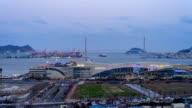 Day to night view of Busan Port International Passenger Terminal and Bukhang Bridge (Busan Harbor Bridge) at night