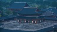 Day to night view of Geunjeongjeon (233rd national treasure of Gyeongbokgung Palace) at sunset