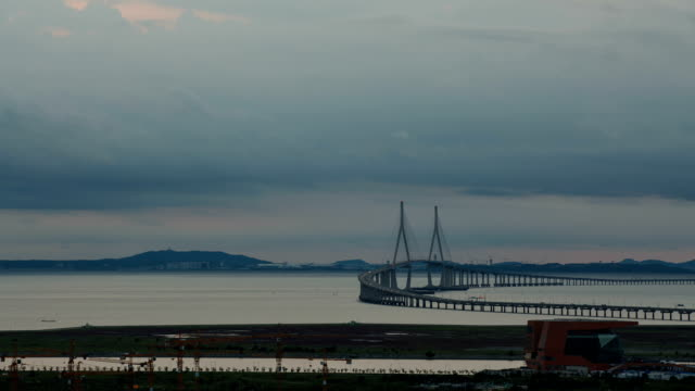 Day to night view of Incheon Bridge (The longest bridge in Korea)
