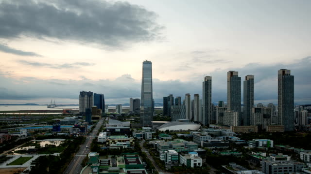 Day to night view of Northeast Asia Trade Tower (Second tallest building in Korea) and Songdo Island (International Business District)