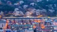 Day to night view of residential district with cherry blossom near Sanbok Road (Famous travel destination in Busan)