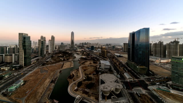 Day to night view of Songdo International Business District (A new smart city or 'ubiquitous city' of South Korea)